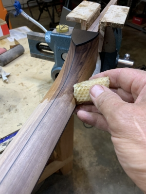 Applying heat-infused beeswax finish to walnut