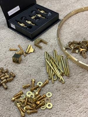Unassembled set of premium solid brass hardware
