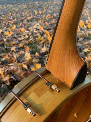 Beautiful tones from a banjo carved from local Osage Orange (Bois d'arc) wood.