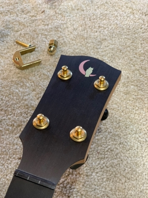 Copper moon & brass owl inlay on ebony peghead