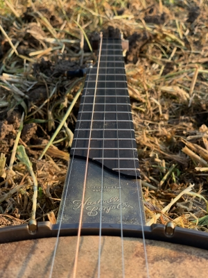 Antiqued Brass standard-etched scoop plate with name and logo on Walnut neck with ebony fingerboard