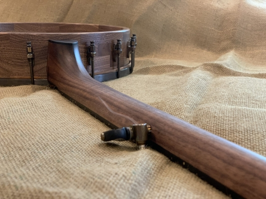Natural beeswax finished walnut neck and hand-rubbed satin poly finished rim